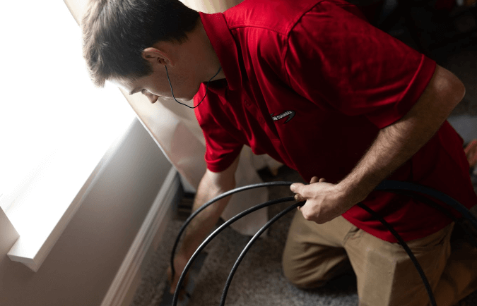 Service man from Clean Air Columbia Cleaning Ducts